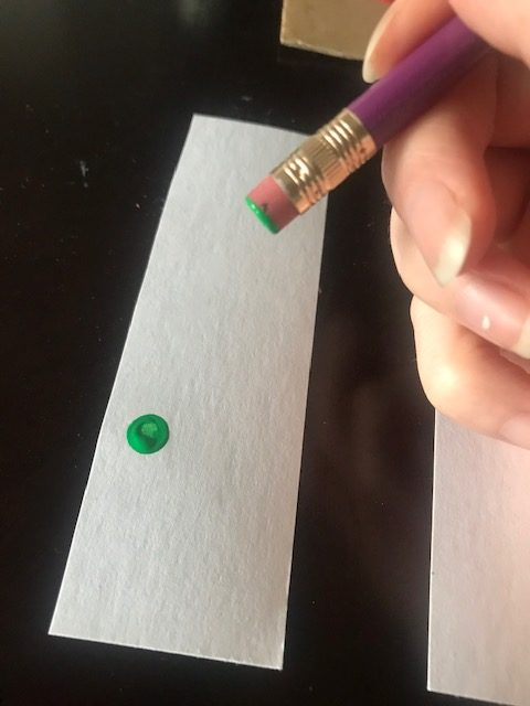 A single dot on a piece of paper