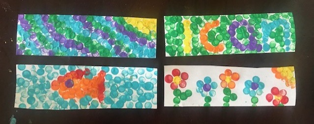 Four finished bookmarks, made using the pointillism style