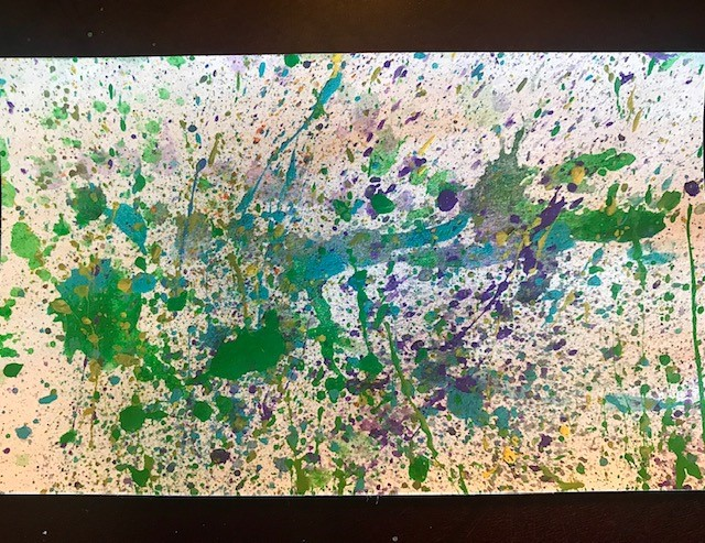 A finished homemade splatter painting