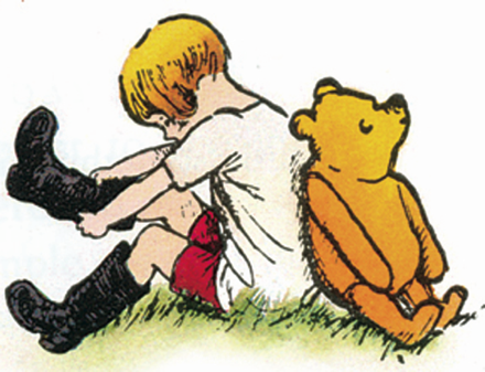 Winnie-the-Pooh bear and Christopher Robin back to back as Christopher pulls on black boots