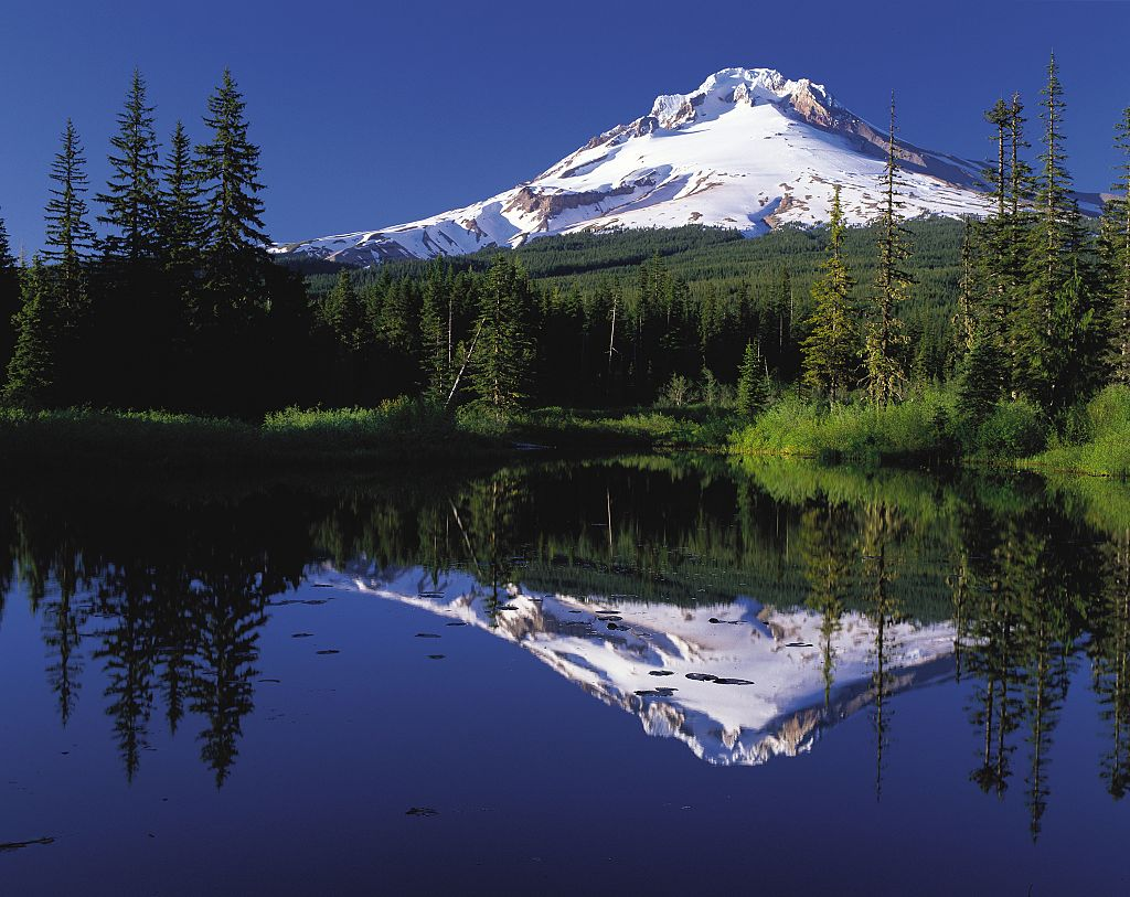 Oregon's Mount Hood towering over and reflecting in Mirror Lake.