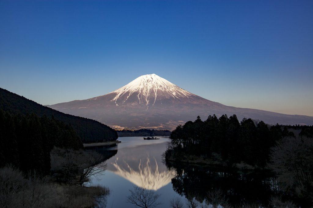 Japan's Mount Fuji towering above and reflecting in Tanuki Lake